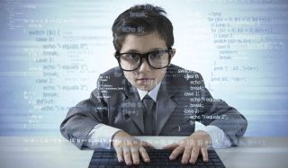 Earnest boy in a suit places hands on keyboard; a translucent field of code fills the foreground