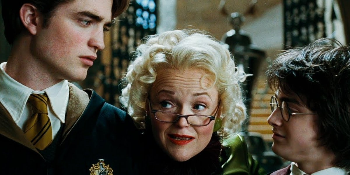 Robert Pattinson, Miranda Richardson, and Daniel Radcliffe in Harry Potter and the Goblet of Fire