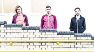 TTNG band shot against a cream wall