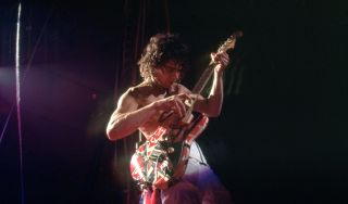 "Eddie Van Halen onstage at the Cobo Arena during Van Halen's ""Fair Warning Tour"" on July 4, 1981, in Detroit, Michigan"
