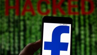 Facebook logo on Android phone superimposed over word 'HACKED' on Matrix-like screen.