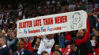 England fans hold up a banner saying - Blatter late than never - in relation to the recent suspension of Sepp Blatter before the UEFA EURO 2016 Qualifier match between England and Estonia at Wembley Stadium on October 9, 2015 in London, United Kingdom.