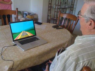 older adult playing video game