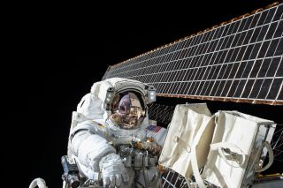 NASA astronaut Scott Kelly is seen during a spacewalk outside the International Space Station on Nov. 6, 2015. He and crewmate Tim Kopra will likely perform a surprise spacewalk on Monday, Dec. 21, to repair the station's stuck Mobile Transporter.