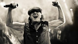 A portrait of Brian Johnson on stage