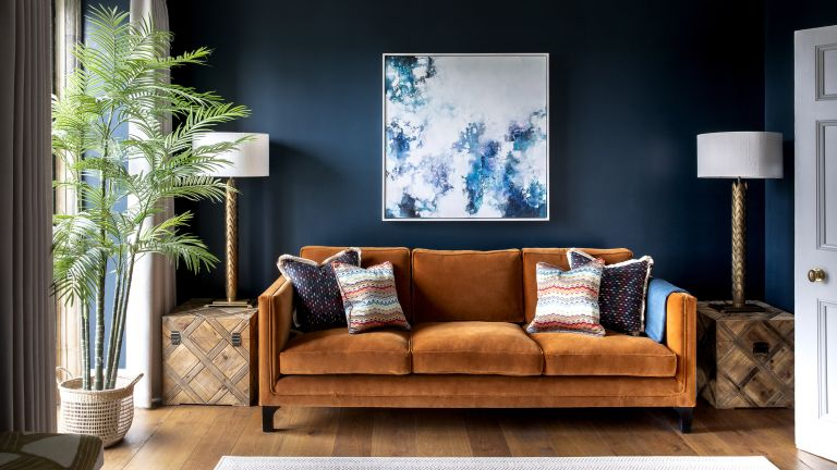 A living room with brown sofa idea with dark blue walls and brown ochre sofa