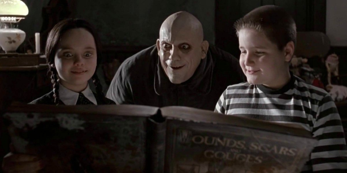 Christina Ricci, Christopher Lloyd, and Jimmy Workman in The Addams Family