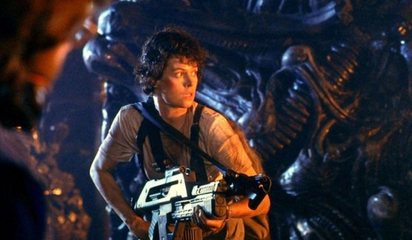 Aliens Ripley walking through the Xenomorph nest with a machine gun
