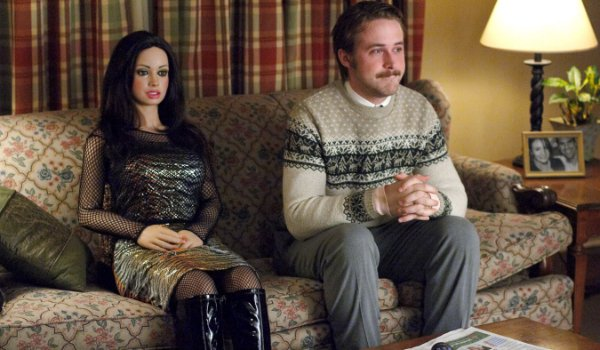 Lars and the Real Girl sit together on the couch