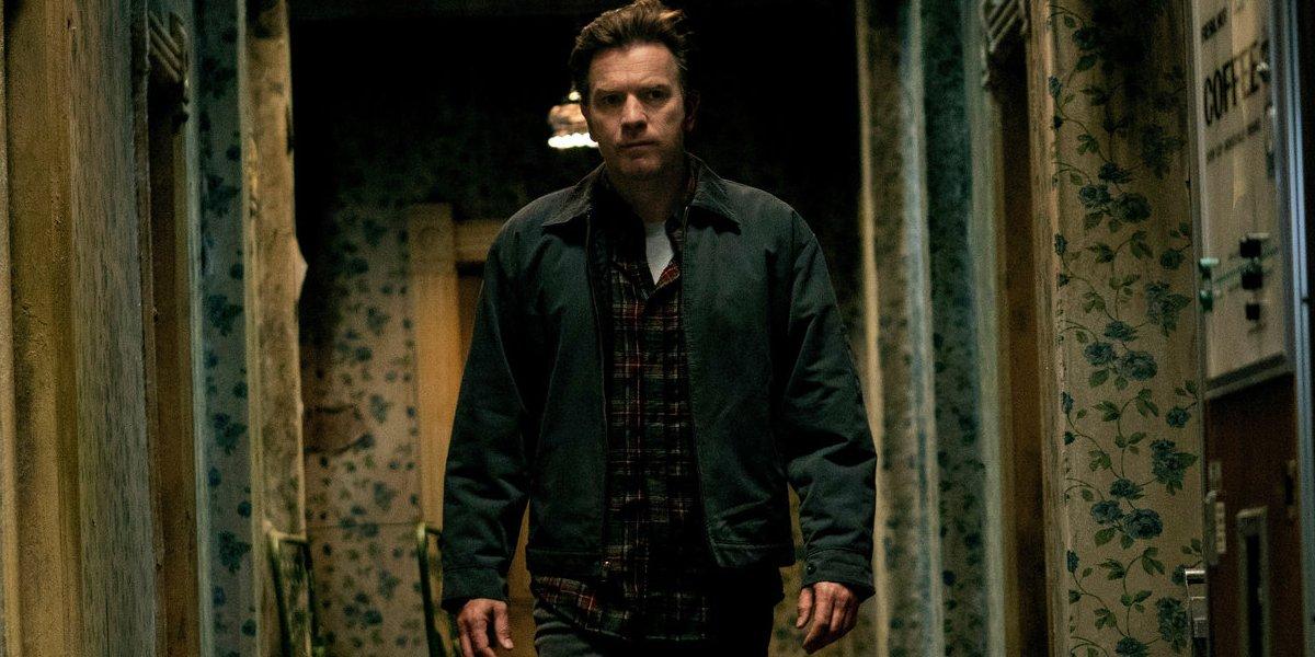 Doctor Sleep Ewan McGregor walking down a hallway of The Overlook Hotel