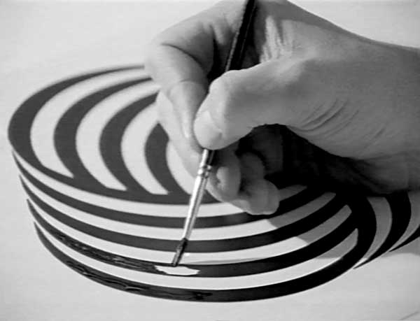 Image of someone painting lines of the Woolmark logo