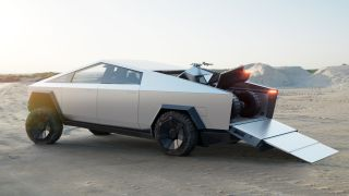 Tesla Cybertruck parked in a desert with an ATV on its flat bed