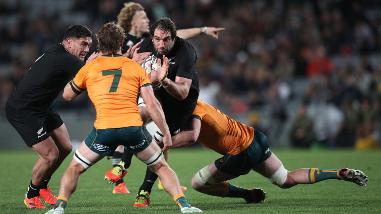 Captain Samuel Whitelock of New Zealand runs into a challenge from Captain Michael Hooper of Australia during The Rugby Championship