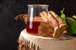 Ayahuasca brew sits on a table in this photograph.