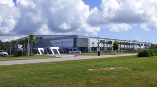 The OneWeb Satellites factory, located just outside the gates of NASA's Kennedy Space Center in Florida, will be able to produce two OneWeb satellites a day when fully operational.