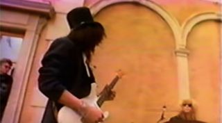 "Slash plays a Stratocaster during the shoot for Guns N' Roses' ""November Rain"" video"