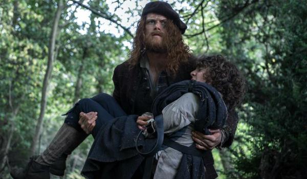 outlander jamie carries fergus starz