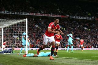 Anthony Martial celebrates scoring during the Emirates FA Cup