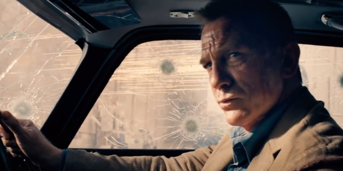No Time To Die James Bond behind the wheel of his banged up car