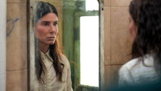 Sandra Bullock stares sadly at herself in the mirror in The Unforgivable.
