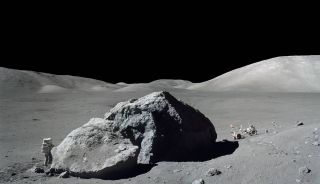 On Dec. 13, 1972, scientist-astronaut Harrison Schmitt is photographed standing next to a huge boulder during the final Apollo moon-landing mission, Apollo 17. This mosaic is made from two photos shot by fellow Apollo 17 moonwalker Eugene Cernan.