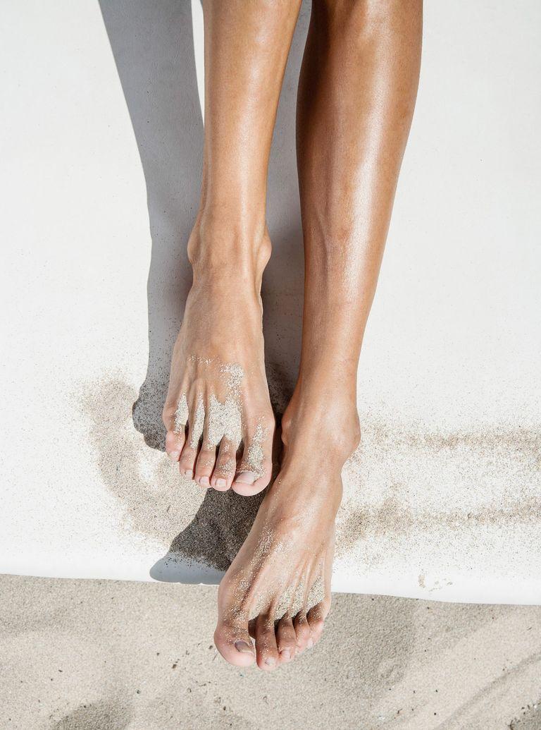 woman's legs on beach