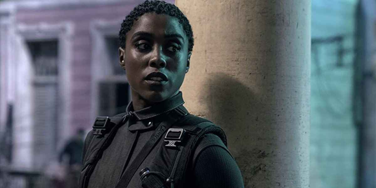 Nomi (Lashana Lynch) stands against a pillar in a scene from 'No Time To Die'
