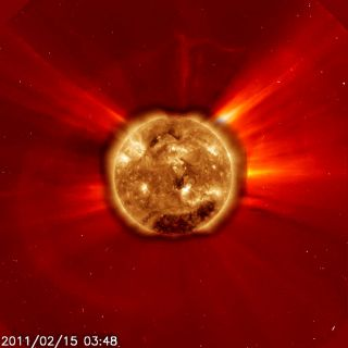 The image of the powerful Class X2 solar flare of Feb. 14, 2011, shows how it appeared to both the Solar Dynamics Observatory in extreme ultraviolet light (center sun disk) and the SOHO's C2 coronagraph. This was the largest flar