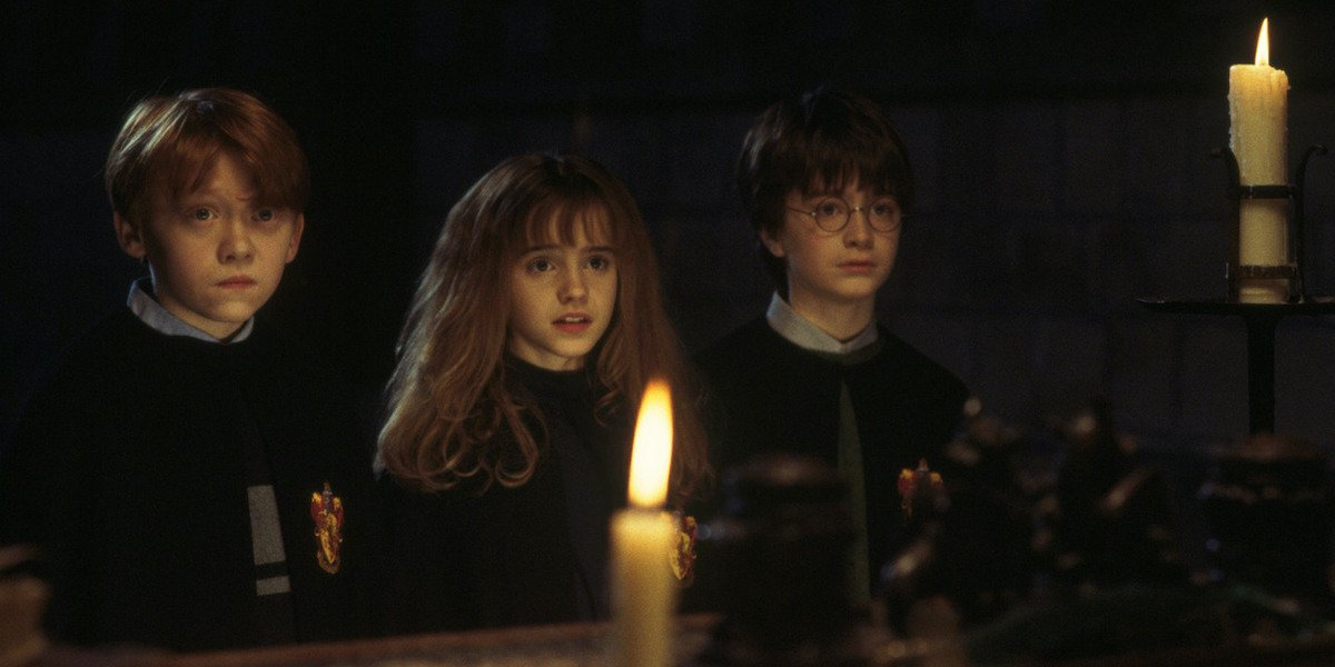 Rupert Grint, Emma Watson and Daniel Radcliffe as Ron, Hermoine and Harry in Sorcerer's Stone