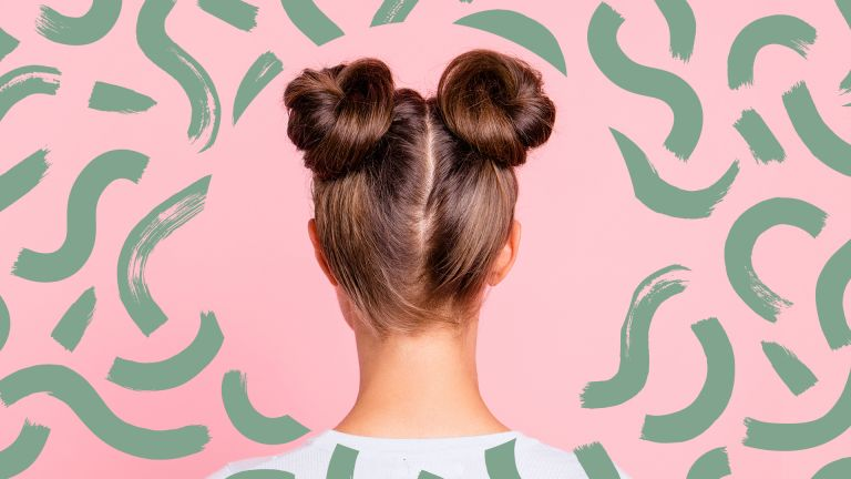 rear view of girl's hair up style with two fashionable buns over pink pastel background with green swirls