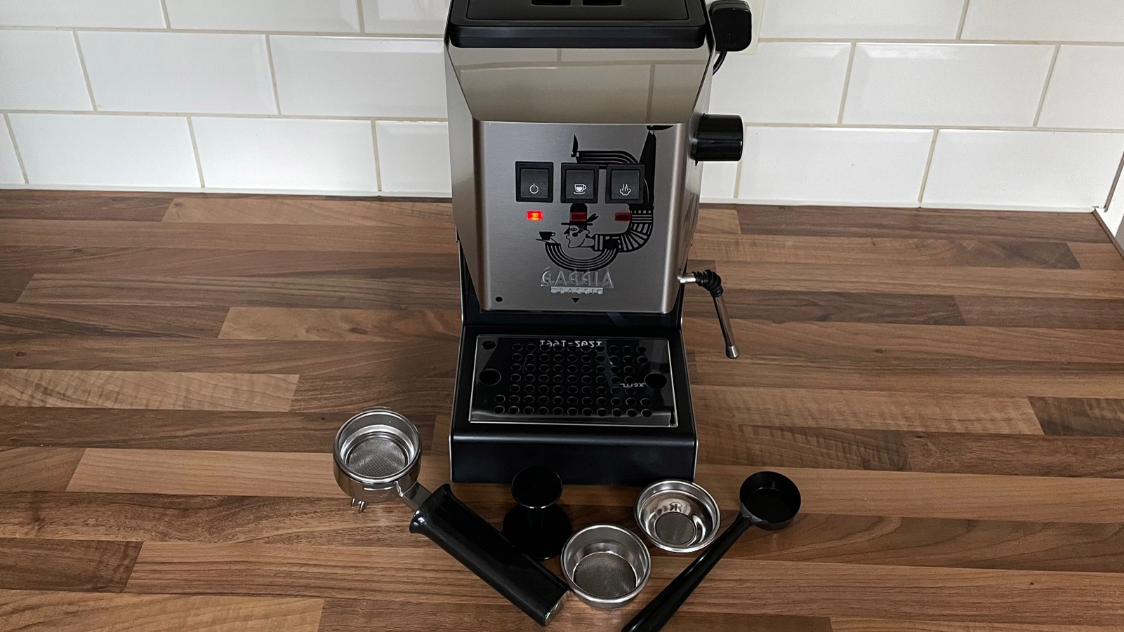 The Gaggia Classic and its accessories on a kitchen countertop