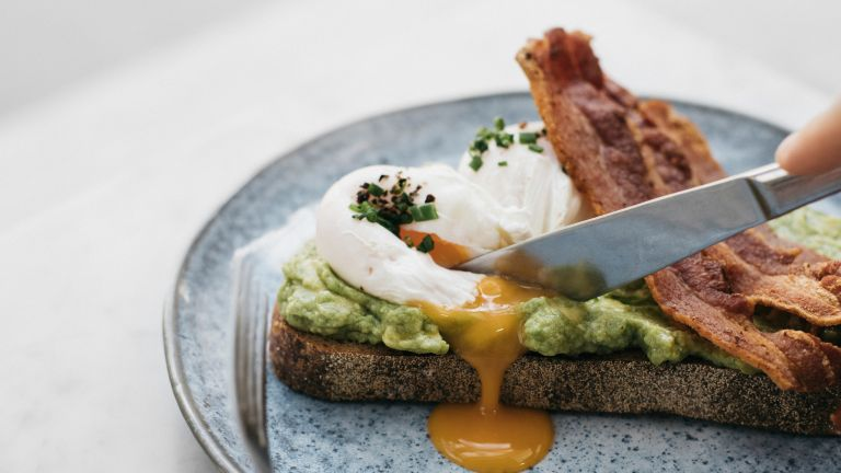 Poached eggs with avocado for breakfast