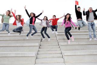 happy teens jumping