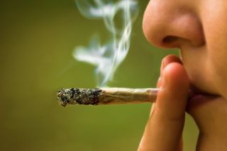 A woman smokes marijuana