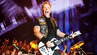 James Hetfield onstage playing guitar