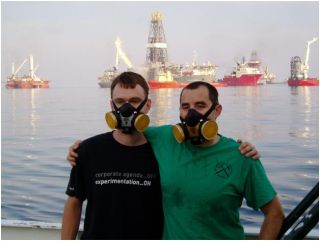 John Kessler and David Valentine in front of ground zero of the Deepwater Horizon Gulf Oil spill in June 2010. Behind the researchers are other vessels also responding to the Gulf oil spill.