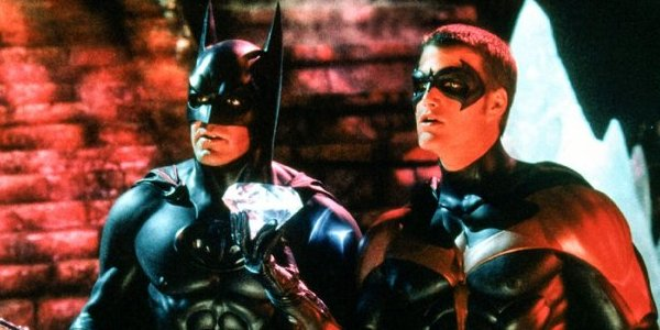 Batman and Robin George Clooney and Chris O'Donnell in costume in front of some steps