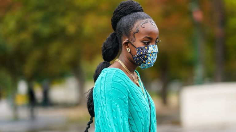 A woman wearing one of the best reusable face masks.