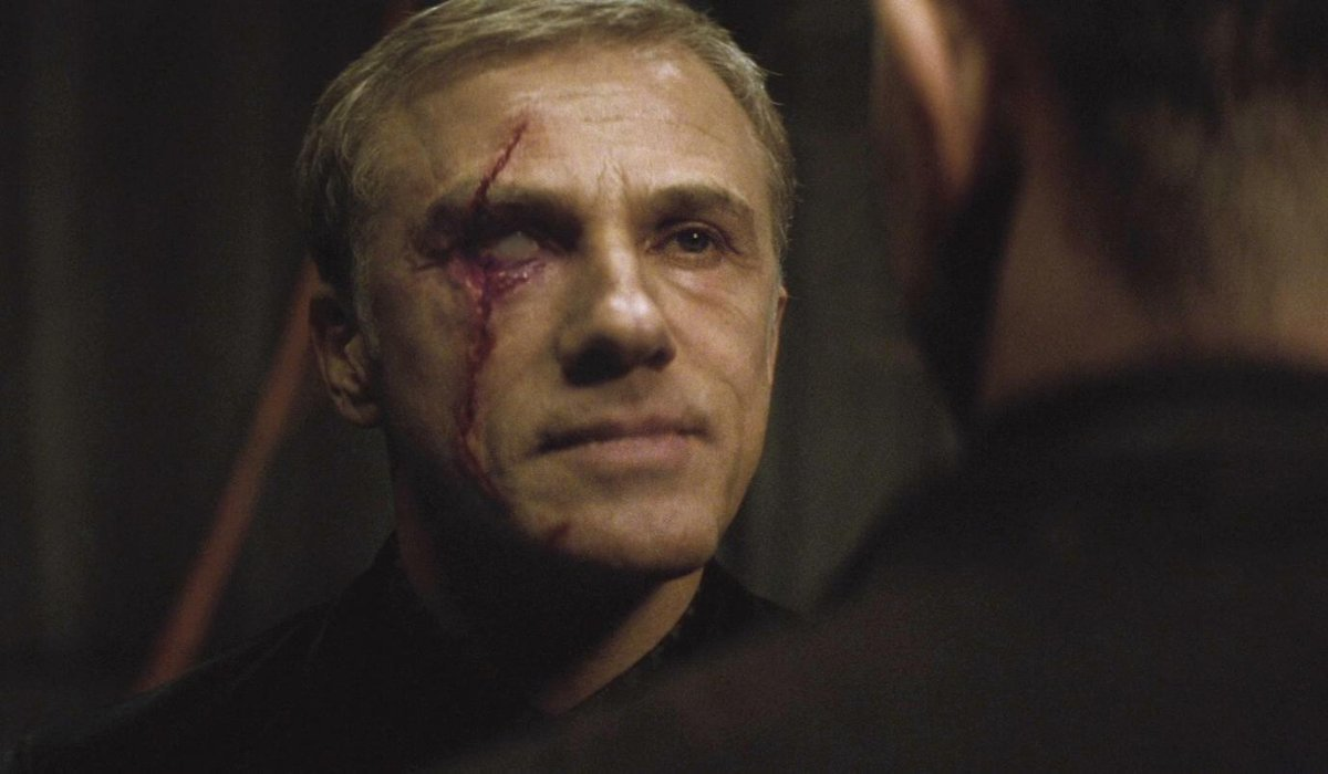Spectre Blofeld eye injury standing in front of Bond
