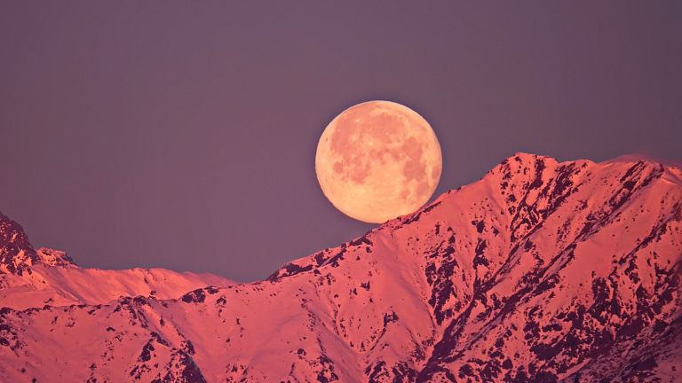 Scenic View Of Snowcapped Mountains Against Sky At Night - stock photo