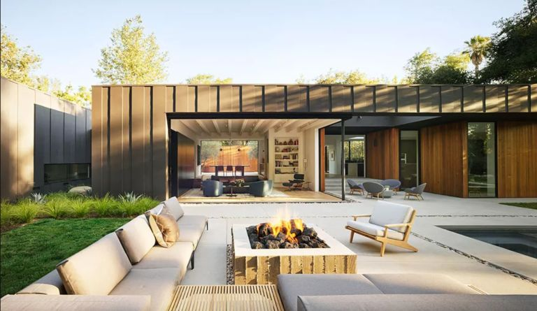 Modern patio with fire pit and outdoor sofas