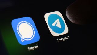 The Signal and Telegram apps grouped together on a smartphone screen.