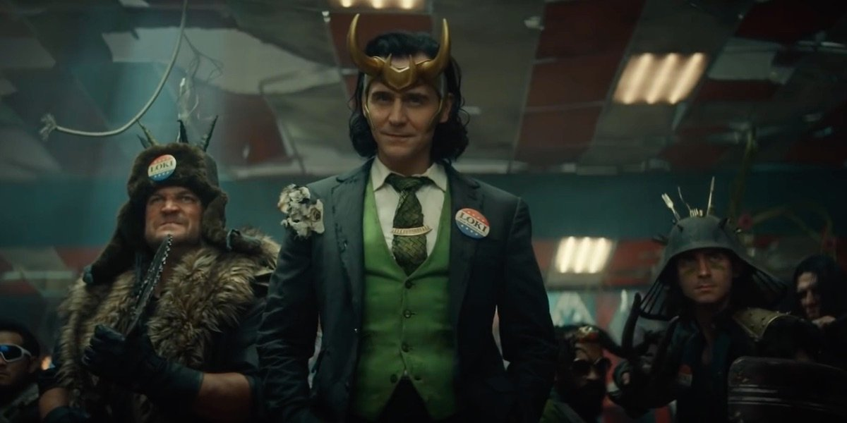 Tom Hiddleston's Loki surrounded by historical figures