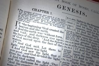 The Bible open to the Book of Genesis.