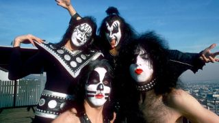 A photograph of Kiss posing on a Los Angeles rooftop taken in 1975