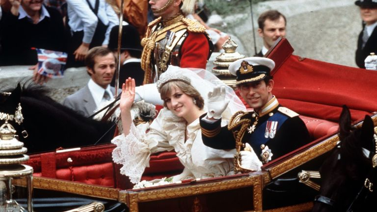 Princess Diana's wedding: The Prince and Princess of Wales smile and wave to the crowds during their carriage procession to Buckingham Palace after their wedding at St.Paul's Cathedral.