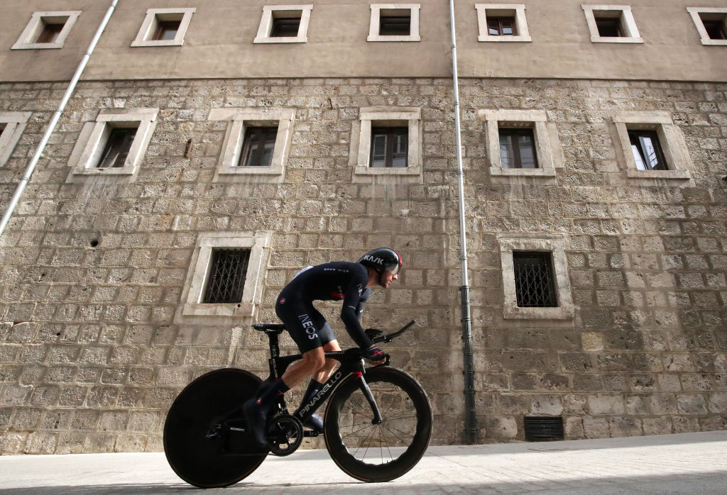 BURGOS SPAIN AUGUST 14 Adam Yates of United Kingdom and Team INEOS Grenadiers competes during the 76th Tour of Spain 2021 Stage 1 a 71km individual time trial from Burgos Catedral de Santa Mara to Burgos lavuelta LaVuelta21 CapitalMundialdelCiclismo catedral2021 on August 14 2021 in Burgos Spain Photo by Gonzalo Arroyo MorenoGetty Images