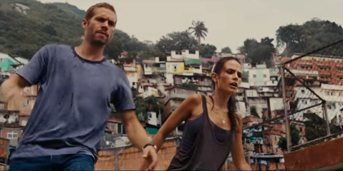 Brian O'Conner and Mia Toretto preparing to jump off a roof in Fast Five