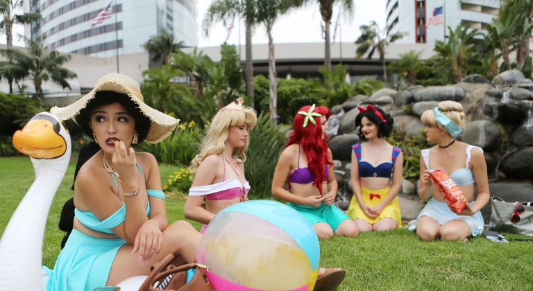 Cosplayers are dressed as the Disney princesses outside Comic-Con on July 20, 2018 at the San Diego Convention Center in San Diego, California.