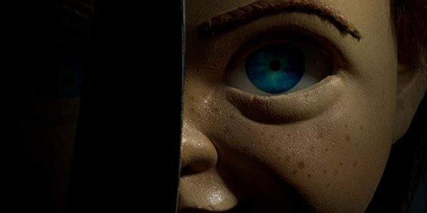 Child's Play Chucky peering out from behind a knife